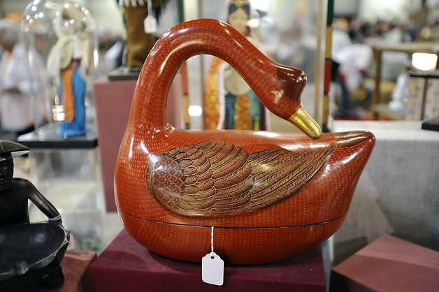 A large red goose shaped covered container is seen on display in the dishware section.  The annual White Elephant Sale preview benefiting the Oakland Museum opened today to large crowds in Oakland, CA Sunday January 27th, 2013. Photo: Michael Short, Special To The Chronicle
