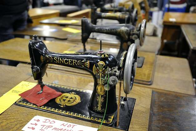 In the sewing and fabric department a line up of antique table top sewing machines is seen on display.  The annual White Elephant Sale preview benefiting the Oakland Museum opened today to large crowds in Oakland, CA Sunday January 27th, 2013. Photo: Michael Short, Special To The Chronicle