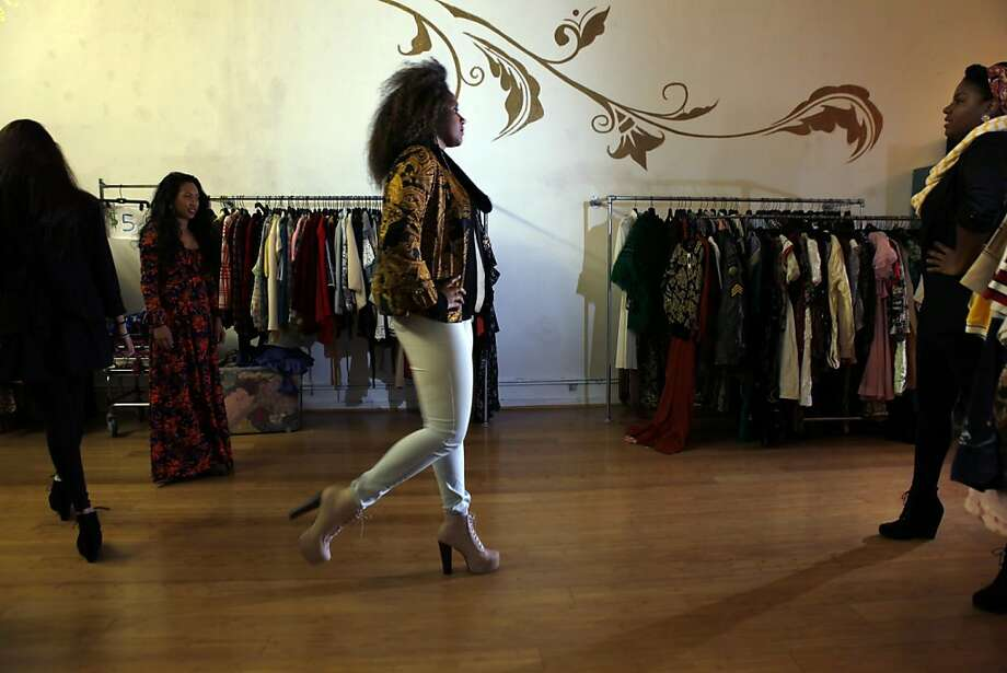 Anna Cissoko of San Francisco shows some sass as she takes part in the modeling collective at 31 Rax. Below, models have the opportunity to rock shoes from the store's collection. Photo: Carlos Avila Gonzalez, The Chronicle