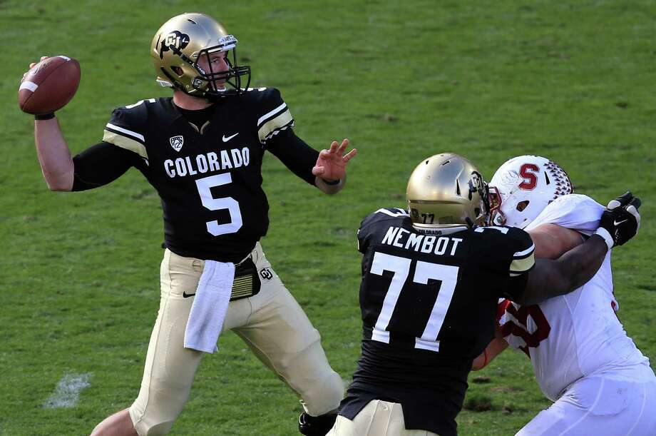 BOULDER, CO - NOVEMBER 03:  Quarterback Connor Wood #5 of the Colorado Buffaloes delivers a pass against the Stanford Cardinals at Folsom Field on November 3, 2012 in Boulder, Colorado. The Cardinal defeated the Buffaloes 48-0. Photo: Doug Pensinger, Getty Images / 2012 Getty Images