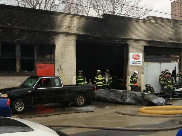 Auto garage fire a smoky scene times union for Garage ww auto