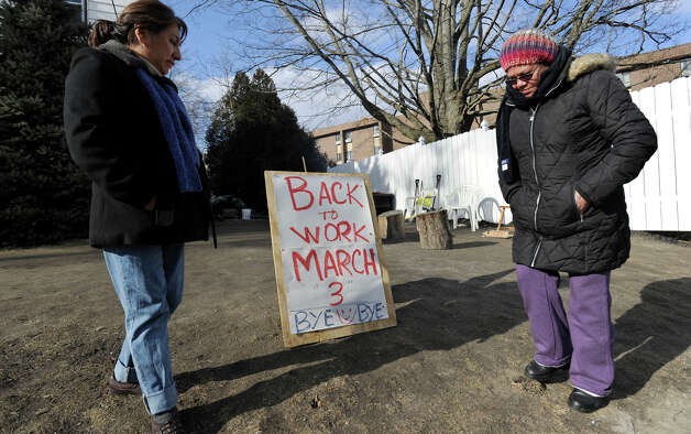 Amy Lastra, 52, left, and Jocelyn Pacete, 56, both of Danbury and CNA's at the Danbury Health Care Center on Osborne Street in Danbury, Conn., are among the workers picketing at the facility on Monday, Feb. 25, 2013. The picketers were scarse in number because many were attending in-service sessions in preparation for a return to work. Photo: Carol Kaliff / The News-Times