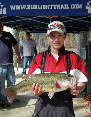 Hunter Moorhead was the first to weigh in, bringing with him a 7.67 lb'r that won 2nd place Big Bass honors.  Photo by Patty Lenderman, Lakecaster
