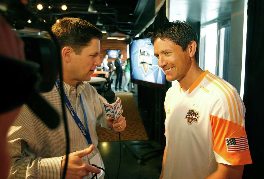 2/25/13: Houston Dynamo Brian Ching at the new Houston Dynamo uniform unveiling at BBVA Stadium in Houston Texas. The new uniforms are a lighter material and have two stars above the Dynamo logo representing the two MLS Cup Championships and a Texas Flag on the bottom of the shirt. Photo: Thomas B. Shea, For The Chronicle / © 2012 Thomas B. Shea