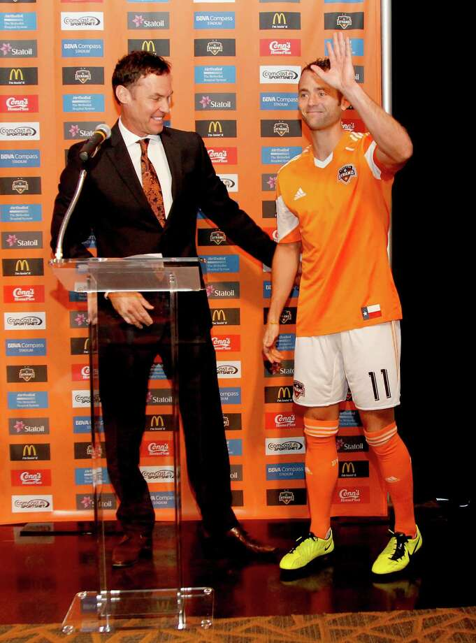 2/25/13: Houston Dynamo Captain, Brad Davis (11) is introduced at the new Houston Dynamo uniform unveiling at BBVA Stadium in Houston Texas. The new uniforms are a lighter material and have two stars above the Dynamo logo representing the two MLS Cup Championships and a Texas Flag on the bottom of the shirt. Photo: Thomas B. Shea, For The Chronicle / © 2012 Thomas B. Shea