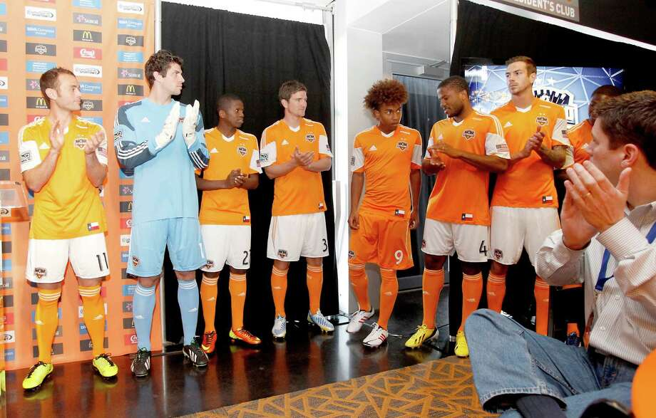 2/25/13: New Houston Dynamo player Brian Salazar (9) is introduced at the new Houston Dynamo uniform unveiling at BBVA Stadium in Houston Texas. The new uniforms are a lighter material and have two stars above the Dynamo logo representing the two MLS Cup Championships and a Texas Flag on the bottom of the shirt. Photo: Thomas B. Shea, For The Chronicle / © 2012 Thomas B. Shea