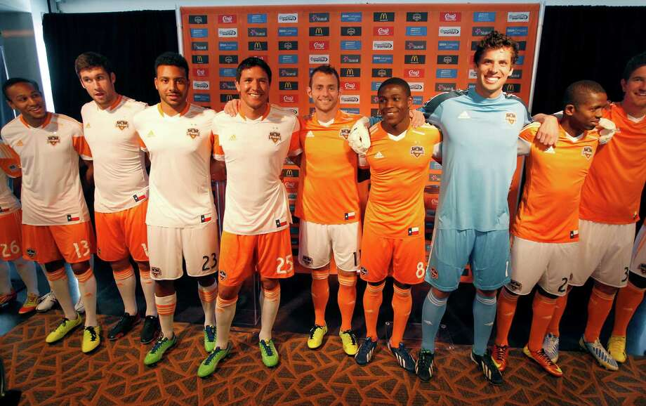 2/25/13: Houston Dynamo players pose at the new Houston Dynamo uniform unveiling at BBVA Stadium in Houston Texas. The new uniforms are a lighter material and have two stars above the Dynamo logo representing the two MLS Cup Championships and a Texas Flag on the bottom of the shirt. Photo: Thomas B. Shea, For The Chronicle / © 2012 Thomas B. Shea