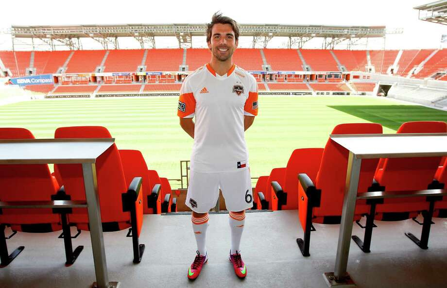 2/25/13: Houston Dynamo Mike Chabala (6) at the new Houston Dynamo uniform unveiling at BBVA Stadium in Houston Texas. The new uniforms are a lighter material and have two stars above the Dynamo logo representing the two MLS Cup Championships and a Texas Flag on the bottom of the shirt. Photo: Thomas B. Shea, For The Chronicle / © 2012 Thomas B. Shea