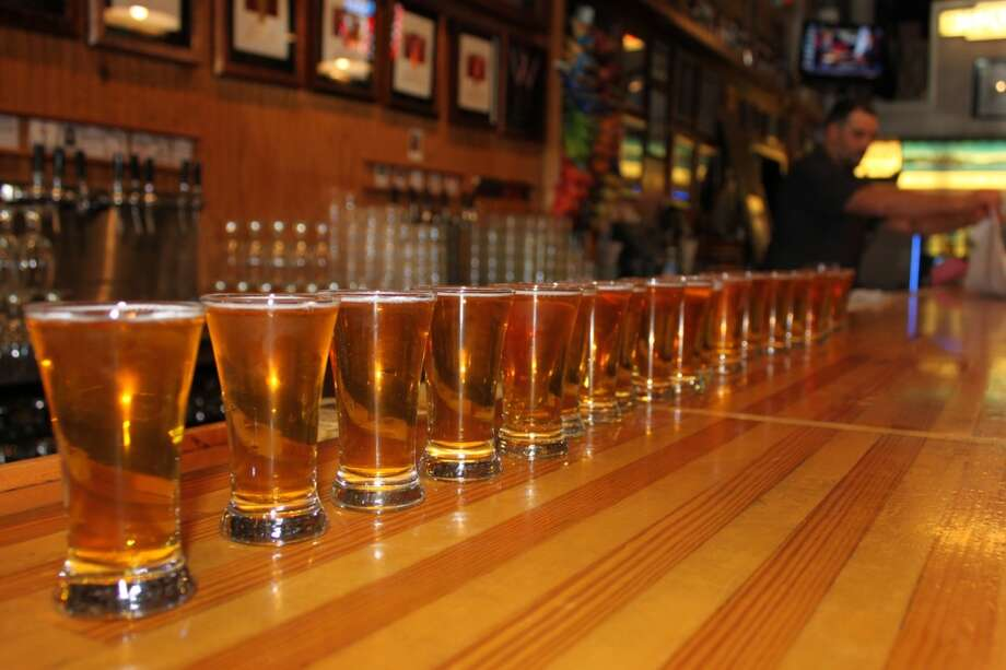In this file photo, Glasses of Pliny the Younger lined up on the bar at Russian River Brewing Co., in Santa Rosa, Calif.