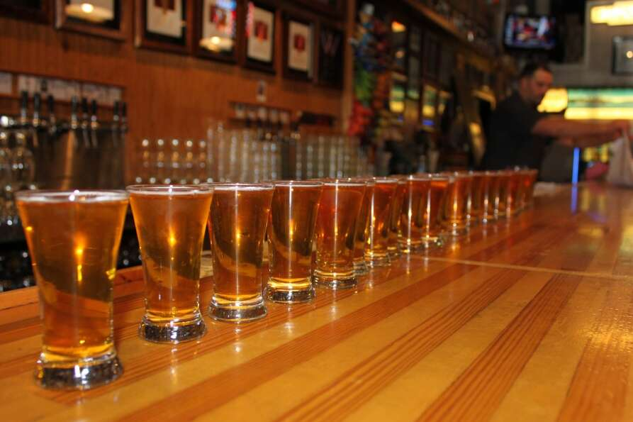 Glasses of Pliny the Younger lined up on the bar at Russian River Brewing Co., in Santa Rosa, Calif.