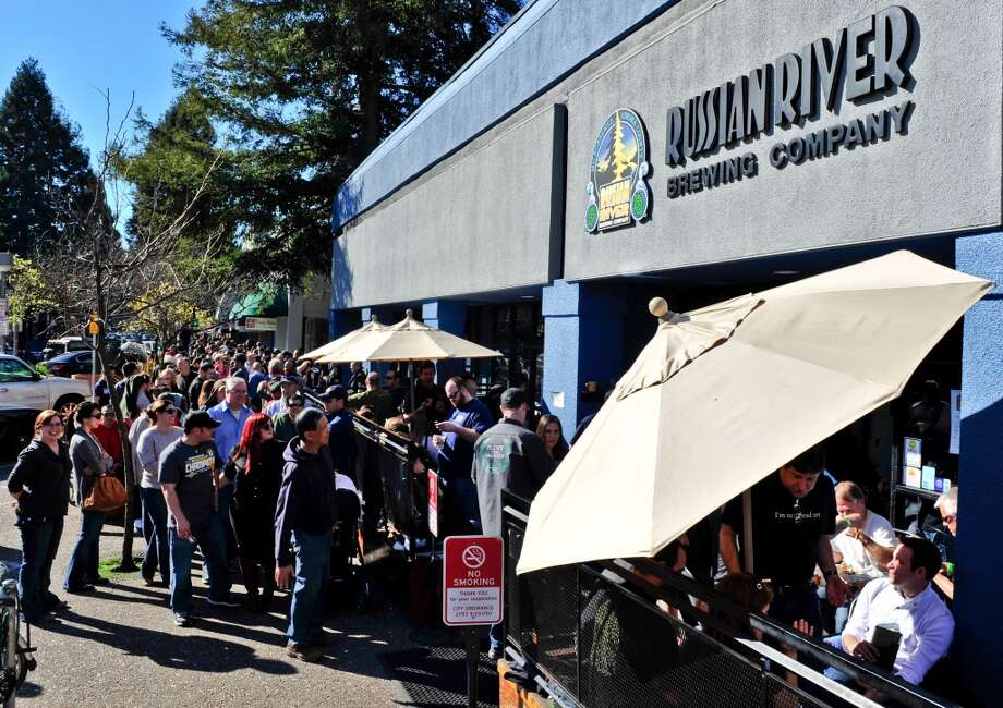 In this file photo, the line of people waiting outside Russian River Brewing Co. for Pliny the Younger