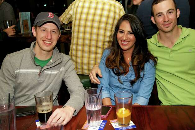 Britton Mac, Christina Portillo, and Travis Thomhoff are at the Flying Saucer Draught Emporium.