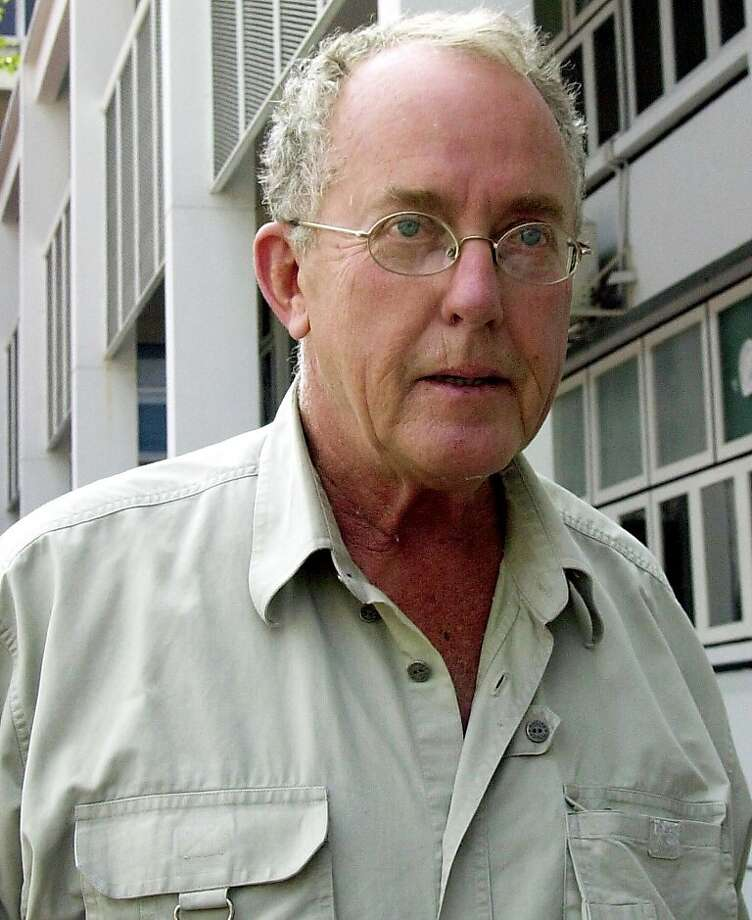 Thomas Frank White, a 67-year-old American from San Francisco, Calif., wanted in Mexico for allegedly molesting and raping minors, is being escorted by police from Thailand's crime suppression division to a Bangkok prison Thursday Feb. 13, 2003. He was arrested Tuesday evening in Bangkok and is awaiting an extradition hearing.(AP Photo/Sakchai lalit)  Ran on: 08-11-2005 Thomas White  Ran on: 08-11-2005 Thomas White Photo: Sakchai Lalit, AP