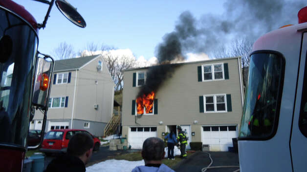 Firefighters saved a dog from this blaze on Glasser Street Monday. Photo: Contributed Photo