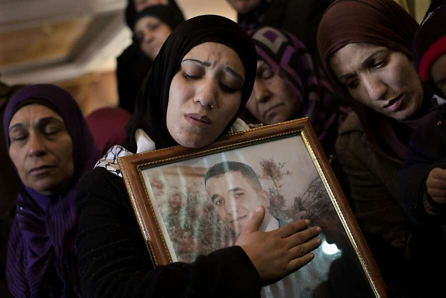 Palestinian women mourn during the funeral of Arafat Jaradat in the West Bank town of Saeer, near He