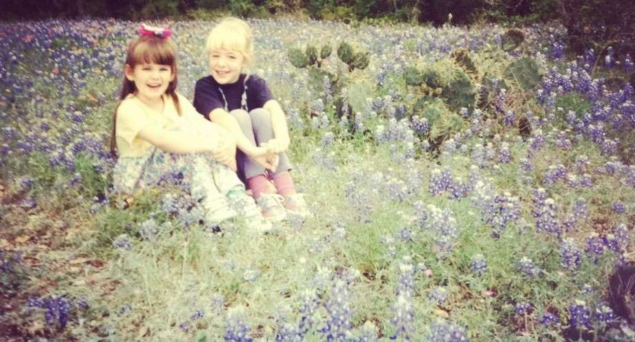 THEN: Growing up in Helotes, Kelly Jonas and Holly MacRossin were best friends. In 1994, they were photographed together in a field of bluebonnets - as all Texas children must be at one time of another. Photo: Courtesy Photo