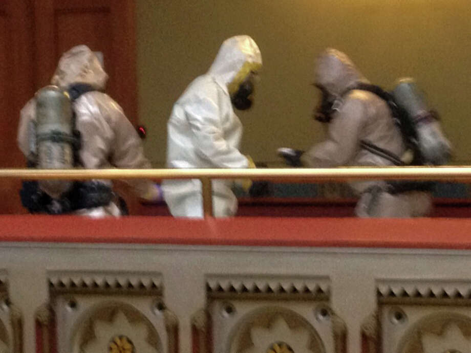 State Police and officials from the Department of Energy and Environmental Protection donned hazardous-material suits to collect a suspicious letter found in a fourth-floor office of the Capitol  in Hartford, Conn. on Monday, Feb. 25, 2013. The incident, in a constituent-services office of Gov. Dannel P. Malloy, was the second suspicious package in the last week. It was reported at about 2:10 p.m. No injuries were reported. A substance described as green and granular, was found in the envelope and sent to the Connecticut State Police lab for testing. Photo: Ken Dixon / Connecticut Post