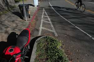 A chicane redirects a morning cyclist in Berkeley on Saturday, Feb. 23. Green Connections is working to install more chicanes to make roads more appealing and safer.