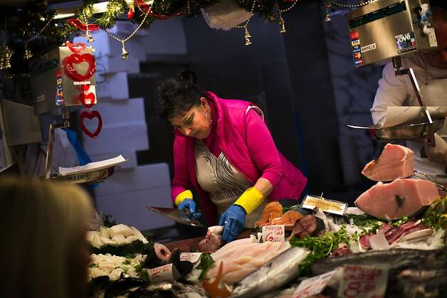 Fish, prepared here by a Barcelona fishmonger, is a staple in the Mediterranean diet, which is praised as being healthy. Photo: Emilio Morenatti, Associated Press