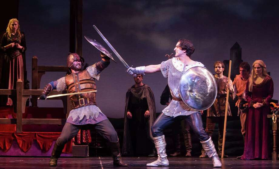 Theatre Under the Stars - CAMELOT - battle between Sir Lionel (left, played by Alexander Levin) and Lancelot (right, played by Sean MacLaughlin) along with the ensemble.   Photo Credit:  Bruce Bennett. Photo: Bruce Bennett / Bruce Bennett 2013 and beyond