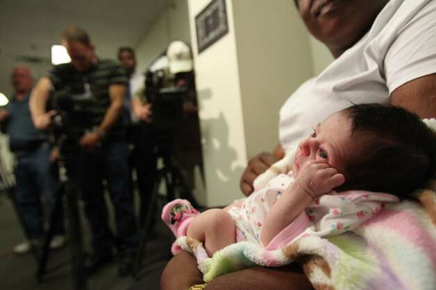 The media gets a glimpse of baby Chloe. Photo: Mayra Beltran/Chronicle