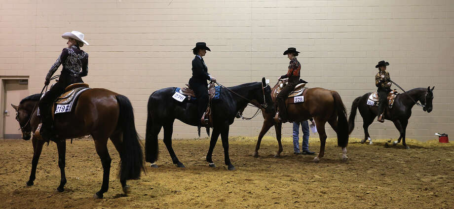 Quarter Horse Show competitors wait their turn in a staging area at the Horse Show Arena of the San Antonio Stock Show and Rodeo, Monday, Feb. 11, 2013. Photo: Jerry Lara, San Antonio Express-News / © 2013 San Antonio Express-News