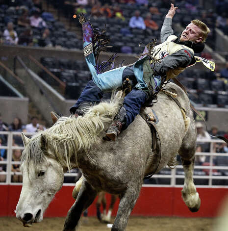 JR Vezain, from Crowley, Wyoming, rides for an 85 score in the bareback competition at the PRCA Rodeo in the AT&T Center on February 14, 2013. Photo: Tom Reel, San Antonio Express-News / San Antonio Express-News