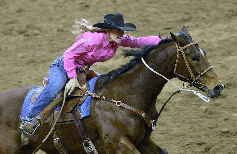 Shada Brazile and her horse run during the barrel racing competition at the San Antonio Stock Show & Rodeo on Saturday, Feb. 23, 2013. Photo: Billy Calzada, San Antonio Express-News / San Antonio Express-News