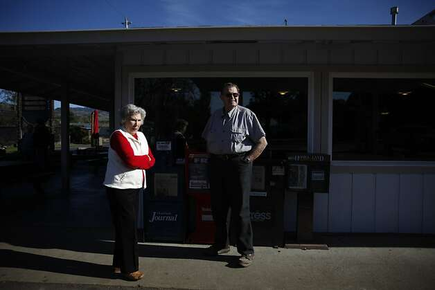 Marian Crosby and Wes Smoot chat outside the Redwood Drive-In. They are two of the 12 residents remaining who are fluent in the town's quirky dialect, which dates to the 19th century. Photo: Lea Suzuki, The Chronicle