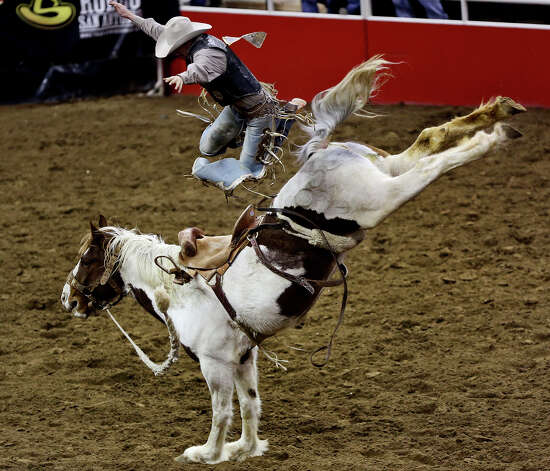 Troy Crowser, of Whitewood, SD, competes in the Saddle Bronc Riding competition during the rodeo at the San Antonio Stock Show and Rodeo at the AT&T Center in San Antonio on Tuesday, Feb. 19, 2013. Crowser won the first round of the semi-finals in Saddle Bronc Riding. Photo: Lisa Krantz, San Antonio Express-News / © 2012 San Antonio Express-News