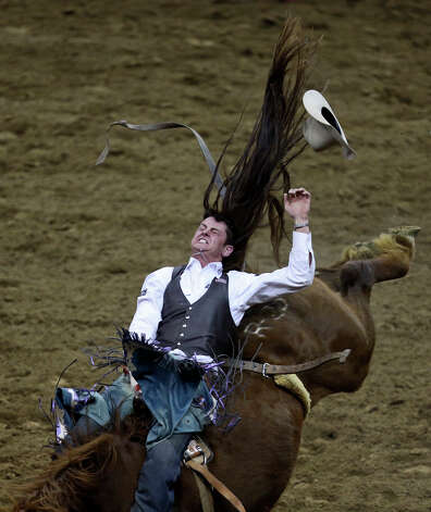 R.C. Landingham, of Grandview, TX, competes in the Bareback Riding competition during the rodeo at the San Antonio Stock Show and Rodeo at the AT&T Center in San Antonio on Tuesday, Feb. 19, 2013. Photo: Lisa Krantz, San Antonio Express-News / © 2012 San Antonio Express-News