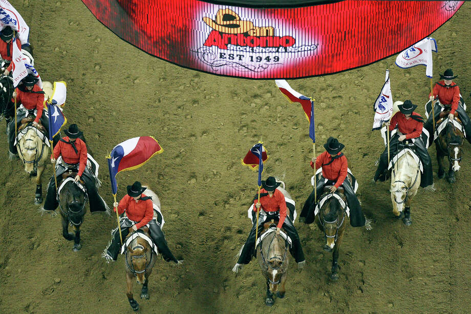 Members of the Palomino Patrol Drill Team take part in the grand entry during the San Antonio Stock Show & Rodeo Thursday Feb. 7, 2013 at the AT&T Center. Photo: Edward A. Ornelas, San Antonio Express-News / © 2013 San Antonio Express-News
