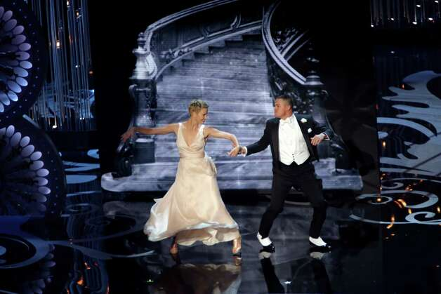 Charlize Theron, left, and Channing Tatum dance during a sketch at the 85th Academy Awards at the Dolby Theatre in Los Angeles, Feb. 24, 2013. (Monica Almeida/The New York Times) Photo: MONICA ALMEIDA / NYTNS