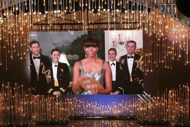 "First lady Michelle Obama announces the award for Best Picture for the film ""Argo,"" live from the White House, during the 85th Academy Awards ceremony at the Dolby Theatre in Los Angeles, Feb. 24, 2013. (Monica Almeida/The New York Times) Photo: MONICA ALMEIDA / NYTNS"