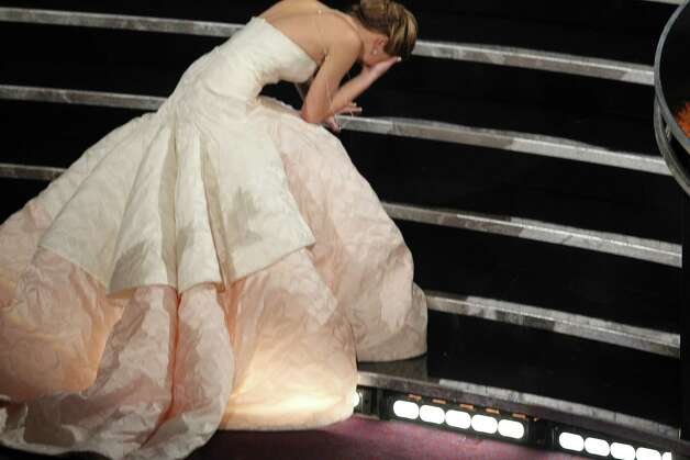 "Jennifer Lawrence falls while on her way to the stage to receive the award for best actress for her role in the film ""Silver Linings Playbook,"" during the 85th Academy Awards ceremony at the Dolby Theatre in Los Angeles, Feb. 24, 2013. (Monica Almeida/The New York Times) Photo: MONICA ALMEIDA / NYTNS"
