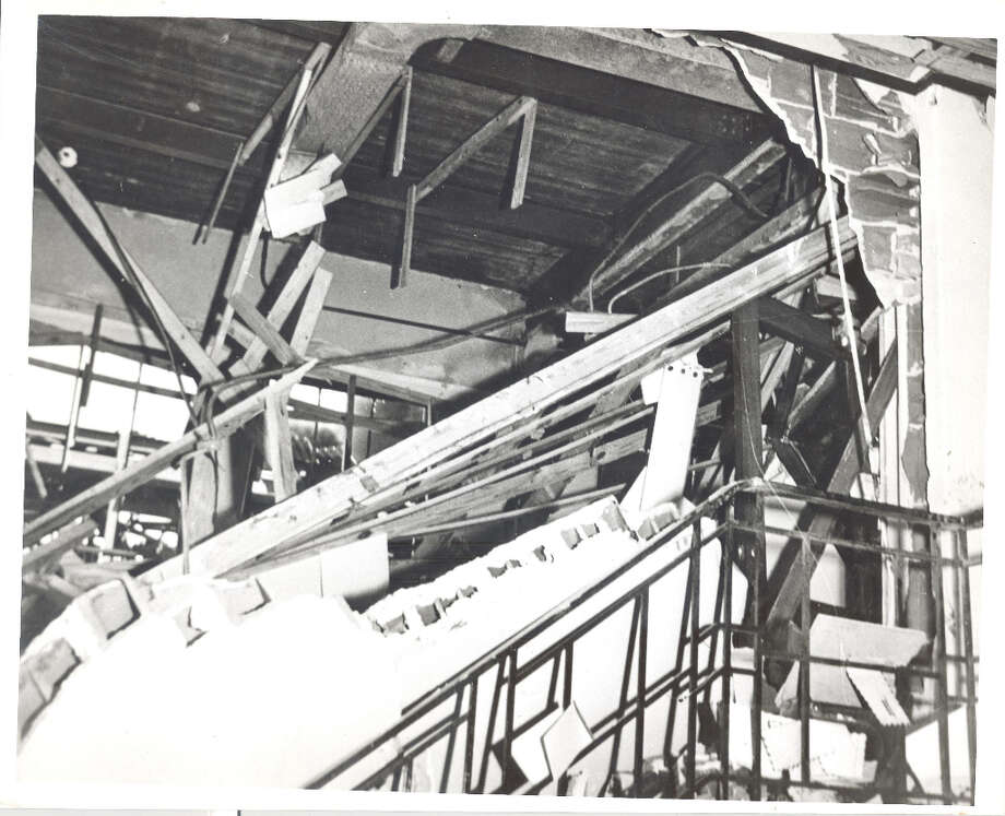 Blasted: This is the interior of the main building of the Monsanto Chemical company's Texas City plant, partially destroyed by explosions and fire Wednesday. Plaster from the ceiling is shown strewn along the stairway, April 16, 1947. Photo: Caroline Valenta : Post Photo / email from John Gonzales