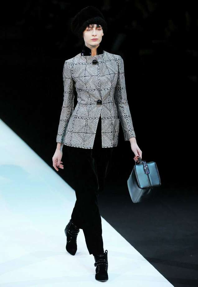 A model wears a creation for Giorgio Armani women's Fall-Winter 2013-14 collection, part of the Milan Fashion Week, unveiled in Milan, Italy, Monday, Feb. 25, 2013. (AP Photo/Antonio Calanni) Photo: Antonio Calanni