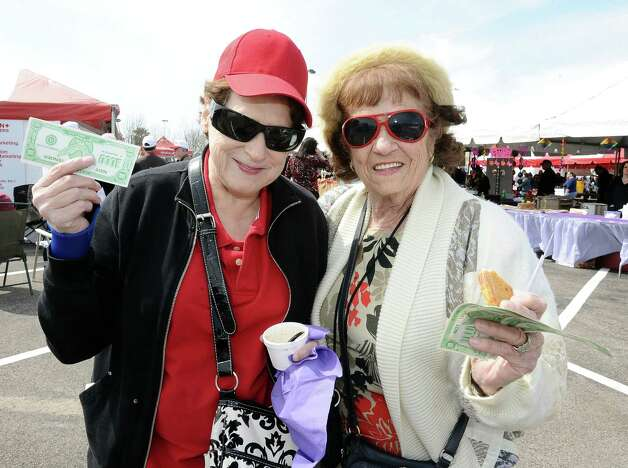 Geraldine Davis, left, and Lynn Ayres, right, get their taste of  UBS gumbo at the 19th Annual Girls' Haven Gumbo Festival at Parkdale Mall on Saturday, February 23, 2013.  Photo taken: Randy Edwards/The Enterprise Photo: Randy Edwards