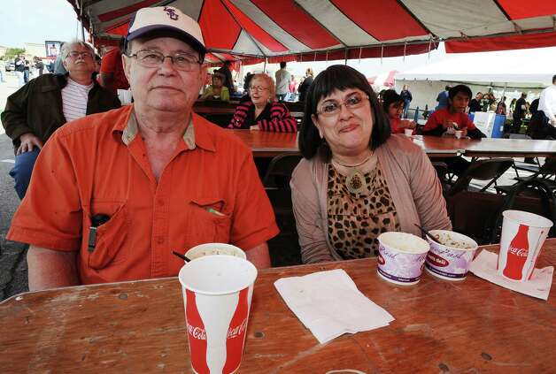 Clarke and Linda Dubose find a spot in the shade to enjoy some gumbo at the 19th Annual Girls' Haven Gumbo Festival at Parkdale Mall on Saturday, February 23, 2013.  Photo taken: Randy Edwards/The Enterprise Photo: Randy Edwards