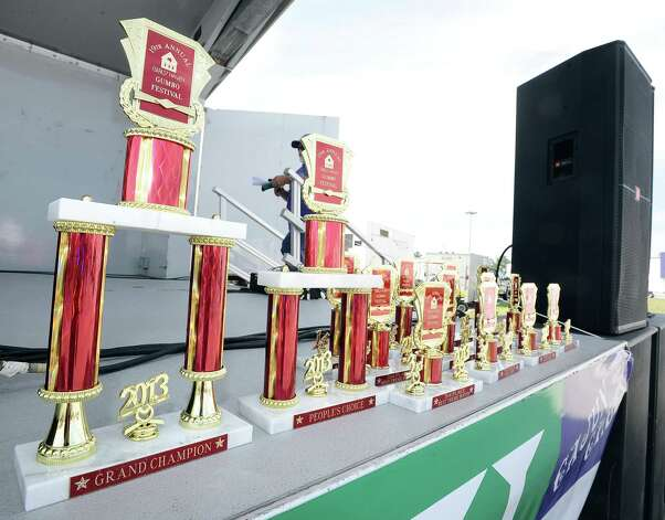 Trophies grace the stage early in the day at the 19th Annual Girls' Haven Gumbo Festival at Parkdale Mall on Saturday, February 23, 2013.  Photo taken: Randy Edwards/The Enterprise Photo: Randy Edwards