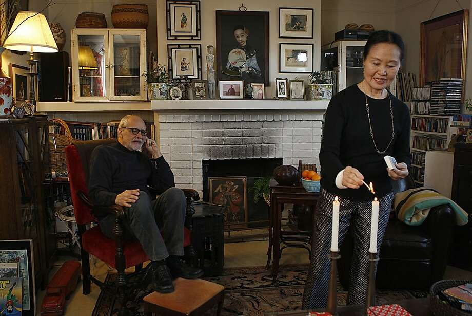 Pat Koltz and his wife, Mary Webb, shown in their living room, have an apartment full of collections. Photo: Liz Hafalia, The Chronicle