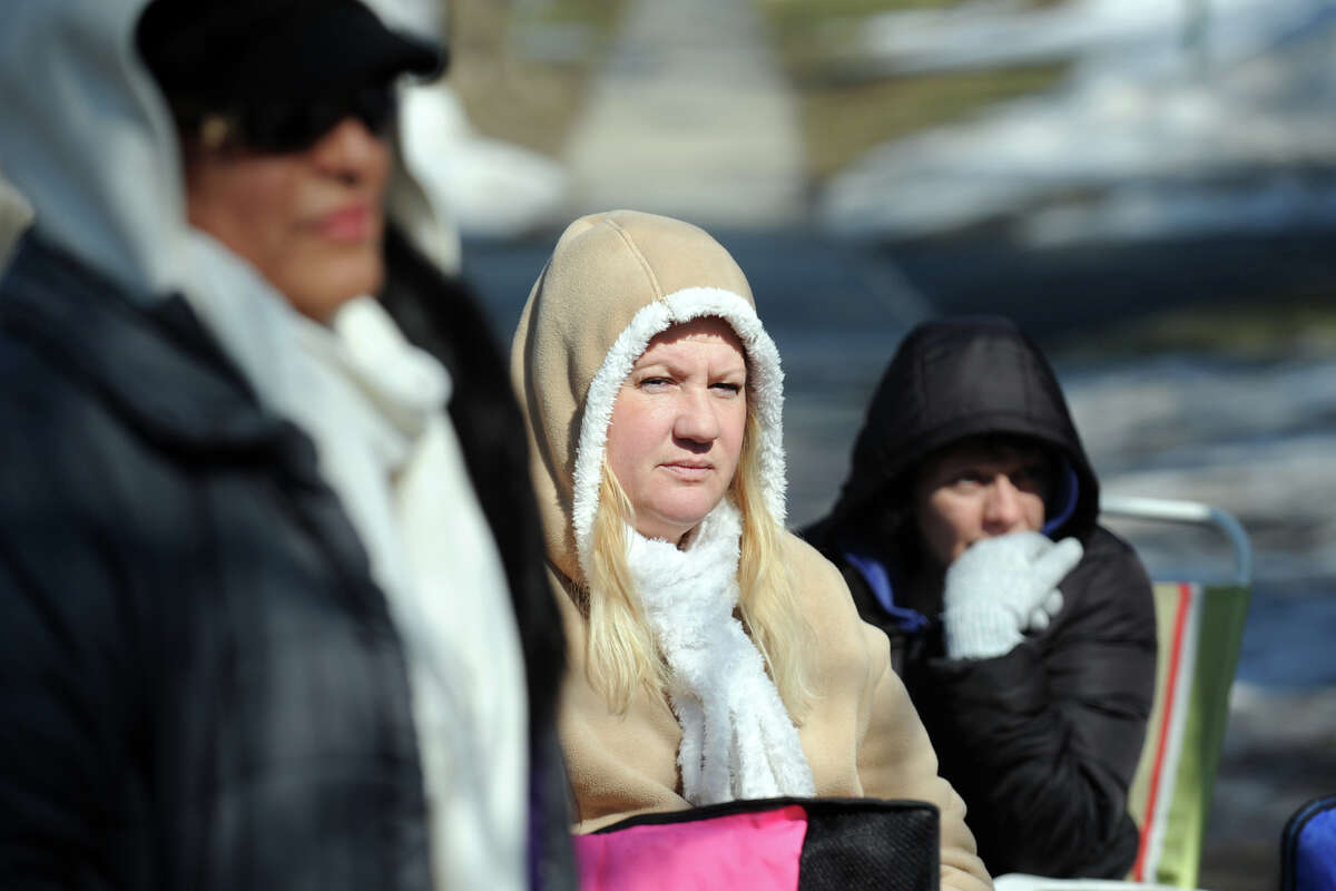 Wendy Russell, center, Rosa Davila, left, and Debbie Wolfe, right, striking health care workers sit in the makeshift strike camp set up near the West River Health Care Center, in Milford, Conn., Feb. 25th, 2013.