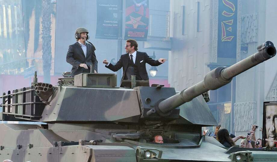 "The students write: ""The 2010 blockbuster, The A-Team, features a scene where the legendary team find themselves falling from an exploded plane in an M1 Abrams tank. In an attempt to prevent their certain death, the A-team fire the tank's main gun downwards to try to slow their descent. Unfortunately for Hannibal, Murdock, Face and B.A., the main gun would need to be fired an infeasible 11 times to make the impact survivable."" Photo: Jon Kopaloff, Multiple / 2010 Jon Kopaloff"