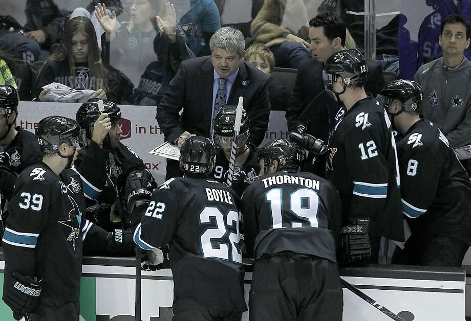 San Jose Sharks head coach Todd McLellan, center, talks with his team during a timeout against the Edmonton Oilers during the shootout period of an NHL hockey game in San Jose, Calif., Thursday, Jan. 29, 2013. The Sharks won 3-2 in a shootout. (AP Photo/Tony Avelar) Photo: Tony Avelar, Associated Press