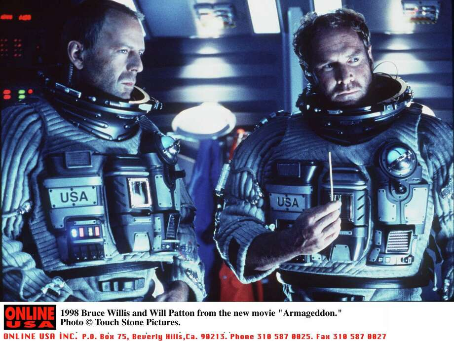 """In 1998 Bruce Willis And Will Patton blow up an asteroid and save the world in """"Armageddon."""" Feasible?  Photo: Getty Images, Multiple / Getty Images North America"""