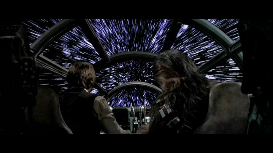 """""""The famous 1970s motion picture Star Wars depicts the stars as stretched beams of light passing the view of the Millennium Falcon as it nears the speed of light. Four physicists from the University of Leicester, Riley Connors, Katie Dexter, Joshua Argyle, and Cameron Scoular, have shown that Han Solo and his companions would not see the stars elongated in this way, due to the laws of special relativity."""" Photo: Multiple"""
