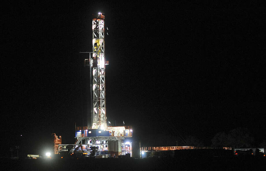 Lights shine on a hydraulic fracturing drilling rig near Three Rivers in South Texas. A panel of CEOs released a plan Monday recommending that the government work more closely with the energy industry to take advantage of rising domestic production. Photo: Associated Press File Photo
