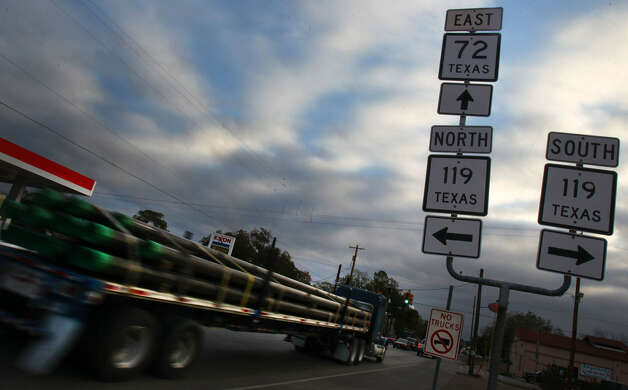 A truck carrying pipe rolls by in Yorktown, south of San Antonio. The town is benefiting from the Eagle Ford Shale, part of rising U.S. energy production. Photo: San Antonio Express-News File Photo