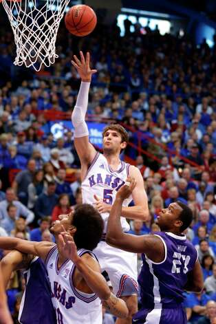 Who's hot:  Kansas C Jeff Withey, who went for 18 points — his best in a conference game this season — in the Jayhawks' victory over TCU. Withey has scored in double figures in 11 consecutive games. And after struggling at the foul line for much of the season, Withey has hit 82.6 percent from the foul line over his last seven games. Photo: Orlin Wagner, Associated Press / AP