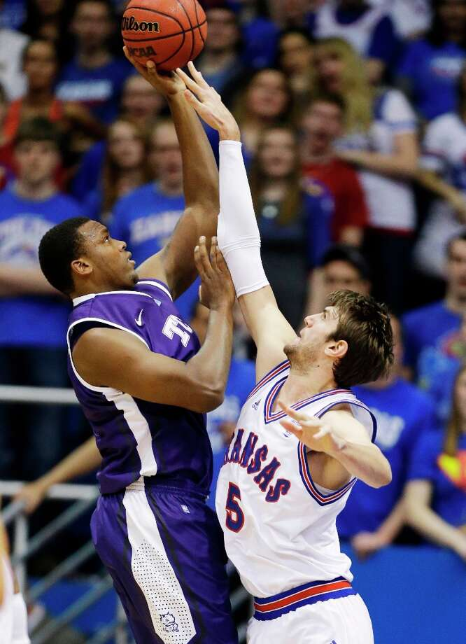 Who's hot:  TCU C Devonta Abron, who went for a career-best 18 points and grabbed nine rebounds in the Horned Frogs' loss at Kansas. Abrams is averaging 12.5 points and 10 rebounds in his last two games. Photo: Orlin Wagner, Associated Press / AP